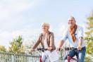 Senior couple with bicycles on bridge